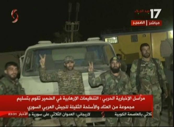Chiến binh Hồi giáo lũ lượt xin hàng, giao nộp vũ khí cho quân đội Syria ảnh 5