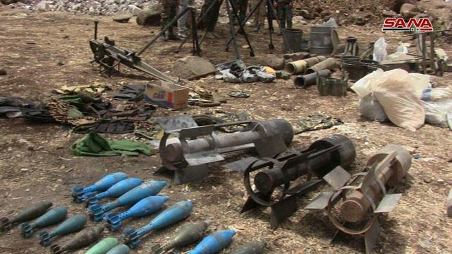 Quân đội Syria chiếm giữ lượng vũ khí khổng lồ của phe thánh chiến ở Homs ảnh 5