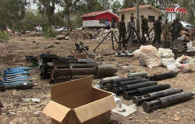 Quân đội Syria chiếm giữ lượng vũ khí khổng lồ của phe thánh chiến ở Homs ảnh 9