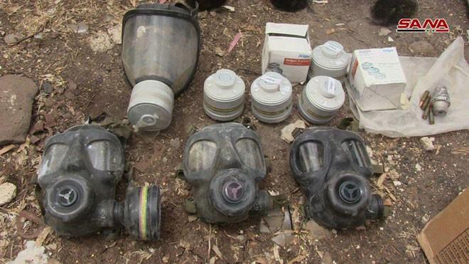 Quân đội Syria chiếm giữ lượng vũ khí khổng lồ của phe thánh chiến ở Homs ảnh 11