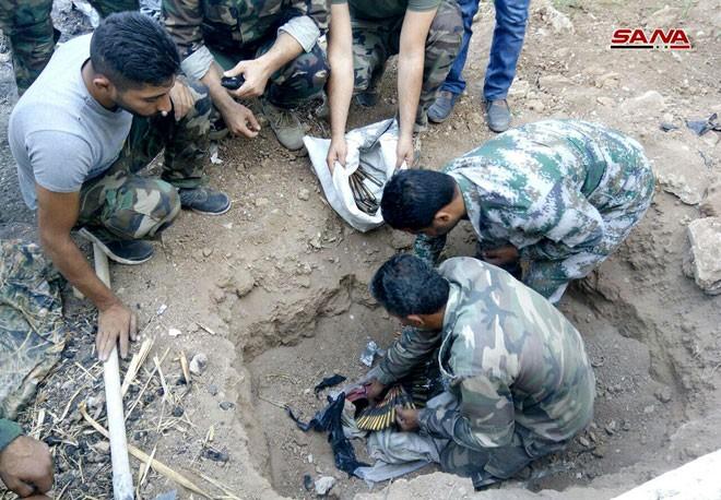 Quân đội Syria chiếm kho vũ khí bí mật của phiến quân Al-Qaeda gần Damascus ảnh 3