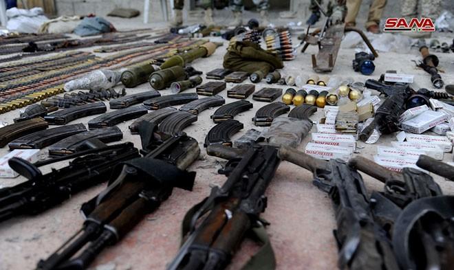 Quân đội Syria chiếm kho vũ khí bí mật của phiến quân Al-Qaeda gần Damascus ảnh 10
