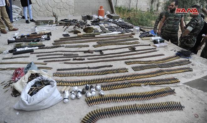 Quân đội Syria chiếm kho vũ khí bí mật của phiến quân Al-Qaeda gần Damascus ảnh 11