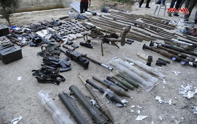 Quân đội Syria chiếm kho vũ khí bí mật của phiến quân Al-Qaeda gần Damascus ảnh 12