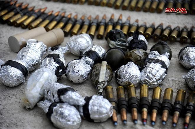 Quân đội Syria chiếm kho vũ khí bí mật của phiến quân Al-Qaeda gần Damascus ảnh 15