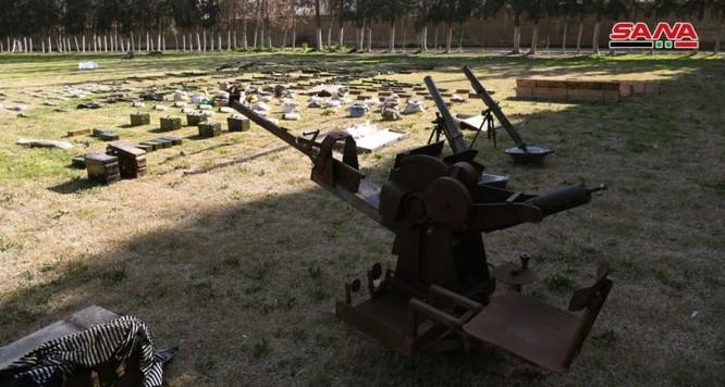 """Quân đội Syria thu giữ một số lượng lớn vũ khí của """"quân nổi dậy"""" ở Đông Ghouta ảnh 5"""