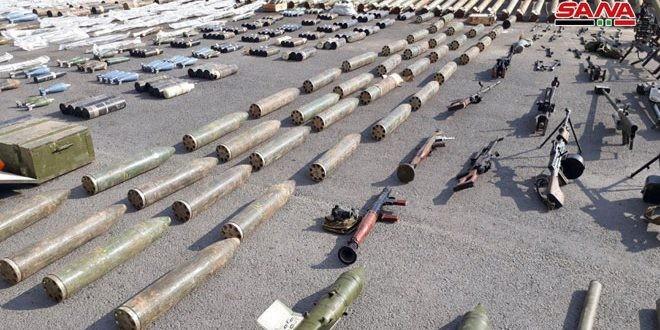 """Quân đội Syria thu hoạch vũ khí của """"quân thánh chiến"""" tại ngoại ô Damascus ảnh 3"""
