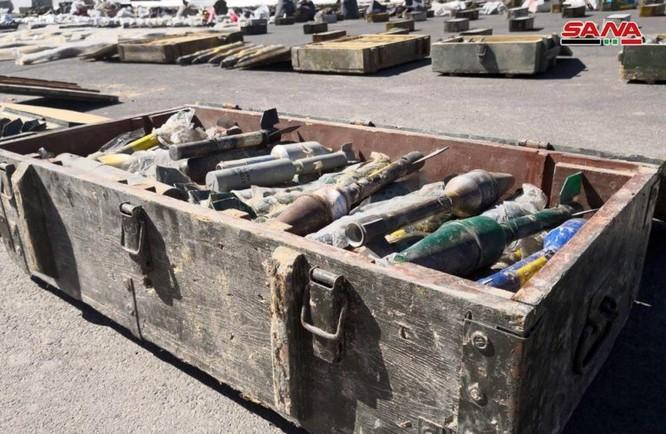 Syria lại thu hoạch một số lượng lớn vũ khí của khủng bố tại ngoại ô Damascus ảnh 9