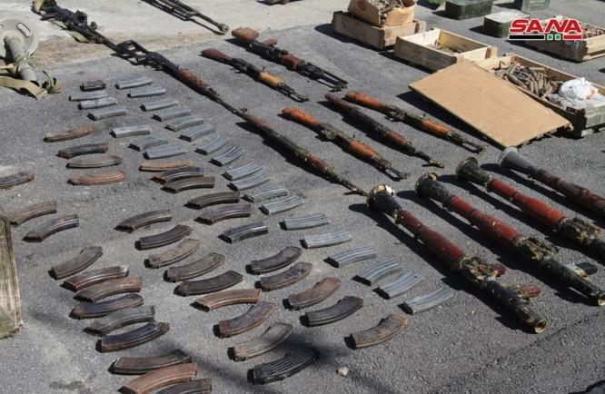 Syria lại thu hoạch một số lượng lớn vũ khí của khủng bố tại ngoại ô Damascus ảnh 10