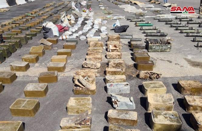 Syria lại thu hoạch một số lượng lớn vũ khí của khủng bố tại ngoại ô Damascus ảnh 11