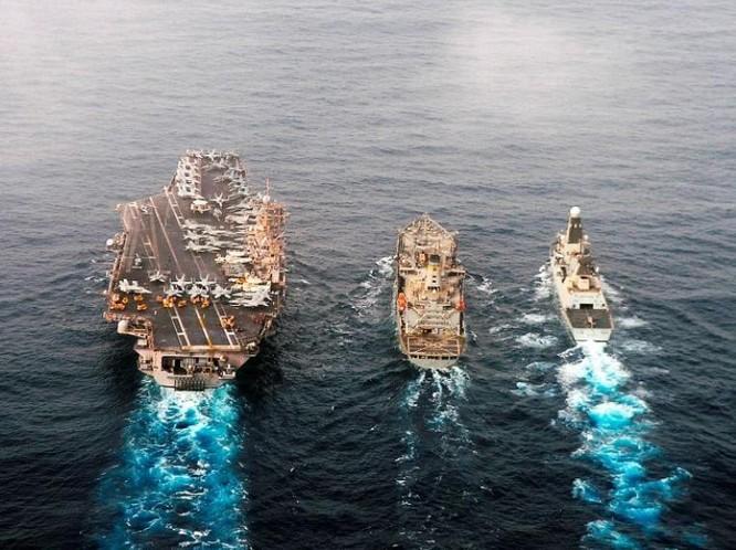 Tàu chiến Anh hành động cùng tàu sân bay Mỹ. Ảnh: Cankao
