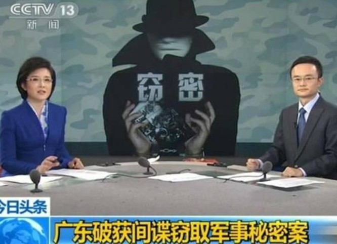 Đài truyền hình Trung Quốc đưa tin bắt giữ gián điệp ăn cắp bí mật quân sự ở tỉnh Quảng Đông. Ảnh: Cankao