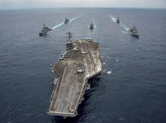 Cụm tấn công tàu sân bay USS Carl Vinson sắp thách thức Trung Quốc ở khu vực Biển Đông. Ảnh: Daily World.