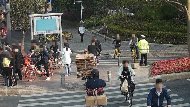 Trung Quốc sử dụng công nghệ nhận diện khuôn mặt để xử phạt người vi phạm giao thông qua SMS - Ảnh 1