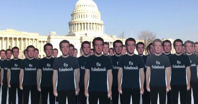 Hàng loạt người biểu tình đeo mặt nạ Zuckerberg và áo phông 'Fix Fakebook' tại Anh ảnh 3