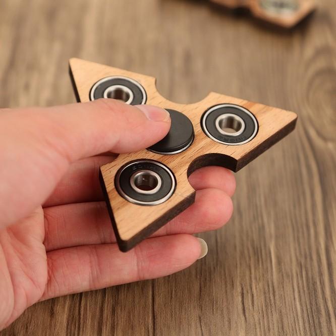 Fidget Spinner là gì? Cách chơi fidget spinner từ dễ đến khó ảnh 2