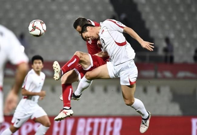 Tinh thần thi đấu là điểm mạnh của các cầu thủ Triều Tiên. Ảnh AFC.