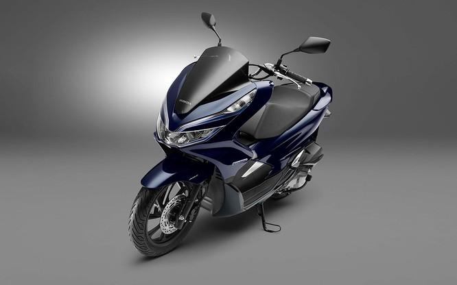 Chỉ tiết kiệm 2% nhiên liệu, cốp bé đi, không ABS, Honda PCX Hybrid có xứng đáng với mức giá 90 triệu ảnh 8