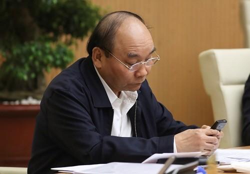 Thủ tướng Nguyễn Xuân Phúc nhắn tin ủng hộ phòng chống dịch COVID-19. Ảnh: VPCP.