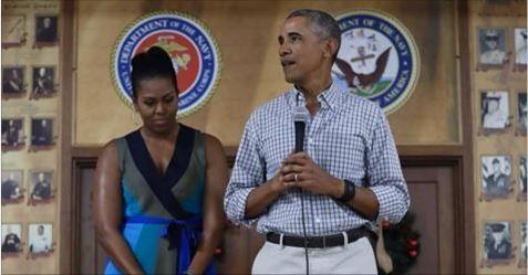 Ông Obama và vợ.