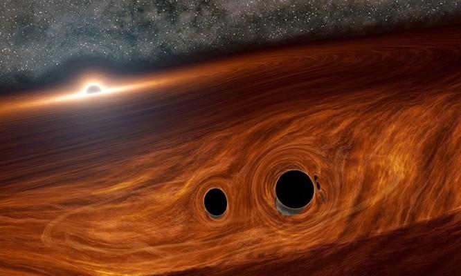 Bất ngờ 2 hố đen vũ trụ sáp nhập tạo ánh sáng mạnh gấp 1.000 tỷ lần mặt trời ảnh 1