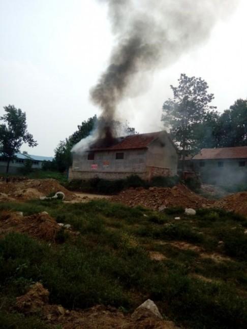 Trung Quốc: Không chịu nhận đền bù, người dân bị thiêu sống? ảnh 1