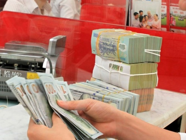 """""""VND có thể giảm 4 đến 5% so với USD trong năm 2016"""" ảnh 1"""