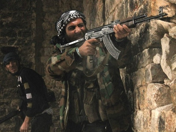 Tay súng phe đối lập Syria. (Ảnh: darkroom.baltimoresun.com)